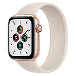 Apple Watch SE GPS + Cellular Gold Aluminium Bracelet Sport Lumière Stellaire 44 mm